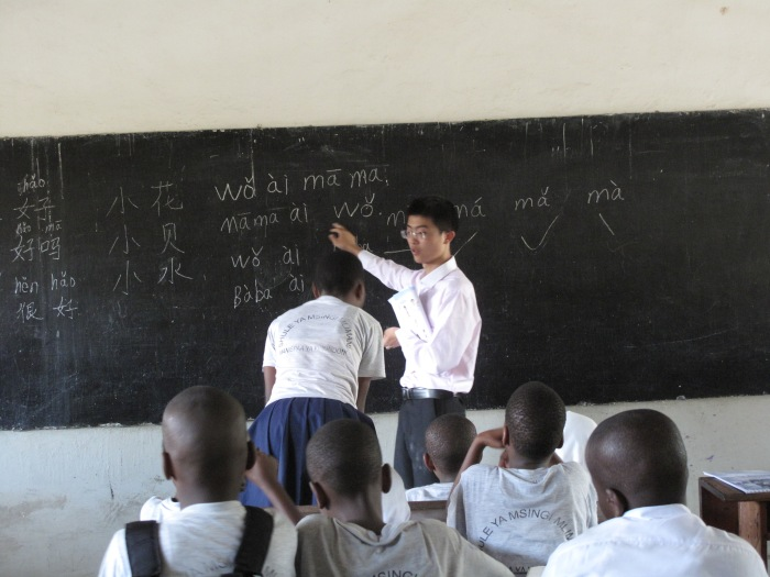 A Chinese graduate gives Tanzanian children their very first Chinese lesson in a Dar Es Salaam school in Tanzania